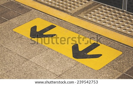 The arrows on the pavement - stock photo