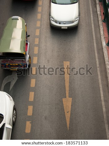 The arrows on the road to a path in the car. - stock photo