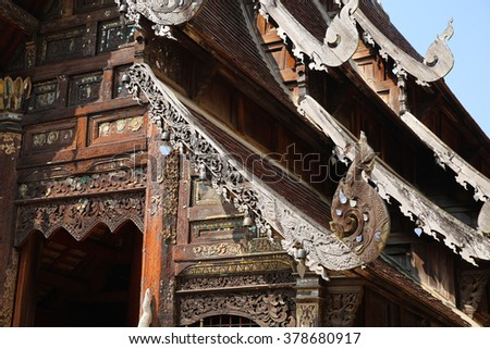 the art design of wooden sculpture on ancient buddhism temple gable - stock photo