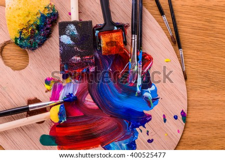 The artist's work. Multi-colored paint on canvas - stock photo