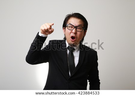 The Asian businessman feeling angry. - stock photo