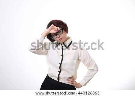 The Asian businesswoman is tried. - stock photo