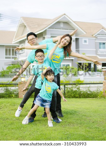 The Asian family play together in the garden  - stock photo