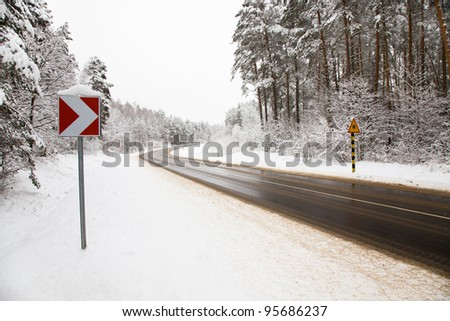 The asphalted road to a winter season - stock photo