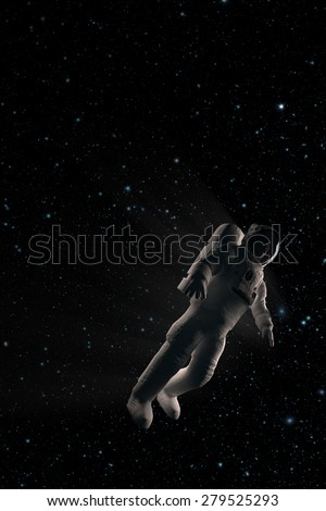 The astronaut in black space - stock photo