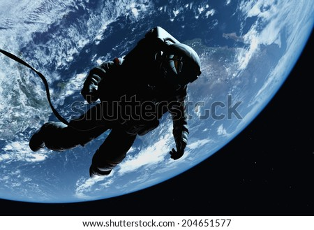 "The astronaut on a background of a planet  ""Elemen ts of this image furnished by NASA"" - stock photo"