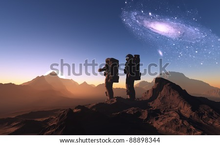 The astronauts on a background of a planet - stock photo
