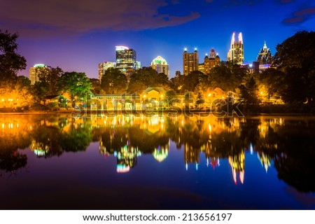 The Atlanta skyline reflecting in Lake Clara Meer in Piedmont Park in Atlanta, Georgia. - stock photo