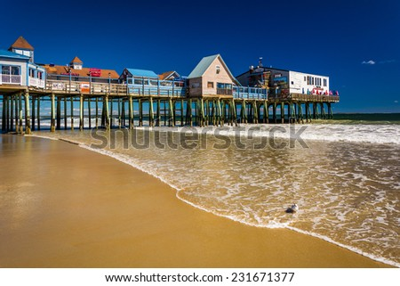 The Atlantic Ocean and pier in Old Orchard Beach, Maine. - stock photo
