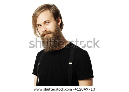 the attractive man the blonde with long hair of the European appearance with a beard in a black t-shirt and black trousers on a white background - stock photo