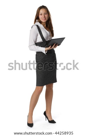 The attractive young woman stands with the laptop on a white background. - stock photo