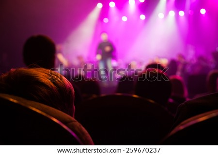 The audience at a concert on the background of the scene. - stock photo