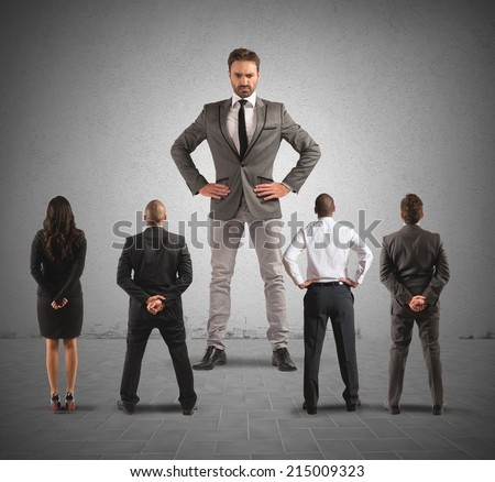 The authoritarian boss in front of his employees - stock photo