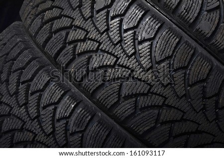 The automobile tire on a black background - stock photo