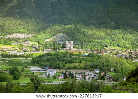 The Aymavilles castle and mountain village in valley of Aosta, Italy - stock photo