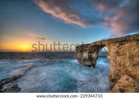 The Azure Window in rough seas in Dwejra, Gozo, Malta. - stock photo