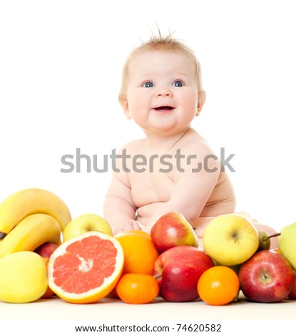 The babe in an environment of the fresh fruit, isolated on the white - stock photo