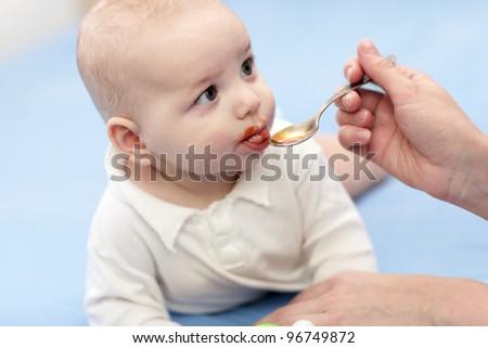 The baby boy takes a iron medicine - stock photo