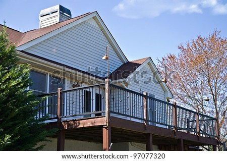 The back deck area of a home, with metal railing. - stock photo