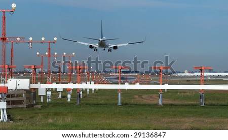 The back view of the landing aircraft - stock photo