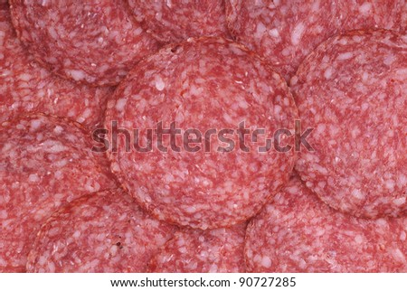 The background - detail of sliced salami - stock photo