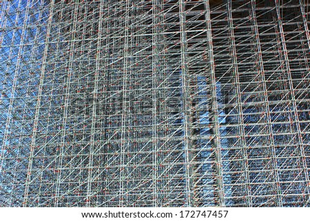 The background of the high-rise structure made of scaffolding - stock photo