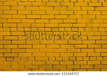 The Background with old yellow painted brick wall - stock photo