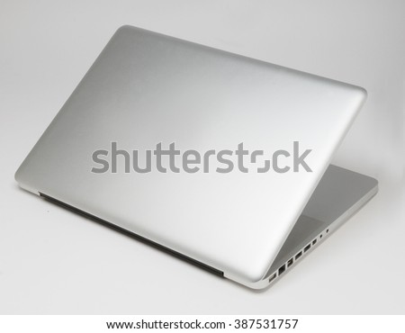 the backside of a laptop with beautiful design isolated with shadows - stock photo