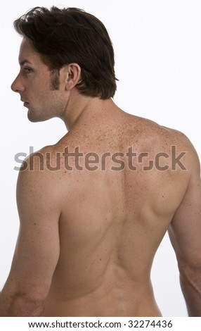 The backside of an attractive well fit man - stock photo