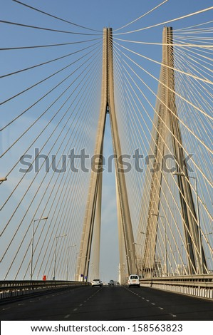 The Bandra–Worli Sea Link, officially called Rajiv Gandhi Sea Link, is a cable-stayed bridge that links Bandra in the Western Suburbs of Mumbai with Worli in South Mumbai. - stock photo
