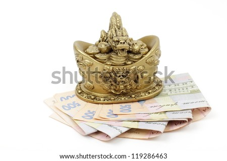 The banknotes from Ukraine of background. Ukrainian money, currency/Studio image of dragon symbol with ukrainian money as a fengshui symbol of wealth - stock photo