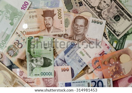 The Banknotes in many different currency. - stock photo
