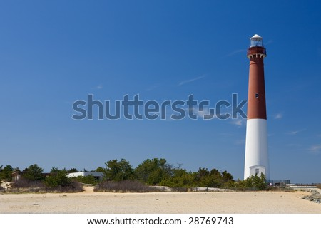 The Barnegat Lighthouse, as seen from the shore - stock photo