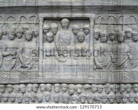 The base of the Obelisk of Thutmosis III showing Emperor Theodosius as he offers a laurel wreath to the victor from the Kathisma at the Hippodrome, Istanbul, Turkey. - stock photo