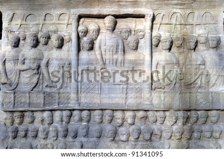 The base of the Obelisk of Thutmosis III showing Emperor Theodosius as he offers a laurel wreath to the victor from the Kathisma at the Hippodrome, Istanbul, Turkey - stock photo