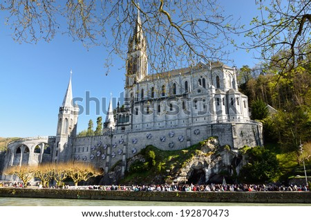 The Basilica of Our Lady of the Immaculate Conception is a Roman Catholic church and minor basilica in Lourdes. It was built on top of the rock above the Grotto. - stock photo