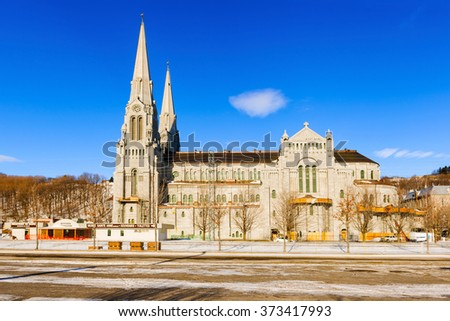 The Basilica of Sainte-Anne-de-Beaupre is a basilica set along the Saint Lawrence River in Quebec, Canada,. It has been credited by  Catholic Church with many miracles of curing the sick and disabled. - stock photo
