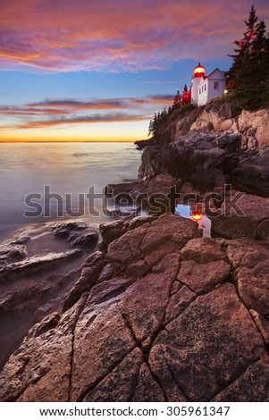 The Bass Harbor Head Lighthouse in Acadia National Park, Maine, USA. Photographed at dusk after a spectacular sunset. - stock photo