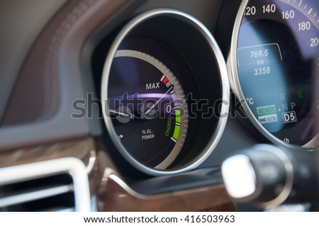 THE BATTERY CHARGE METER ON HYBRID SYSTEM INDICATOR, SELECTIVE FOCUS - stock photo