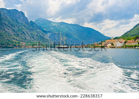 The bay of Kotor looks like norwegian fjord because of the high rocky mountains, surrounding the narrow creek, Montenegro. - stock photo