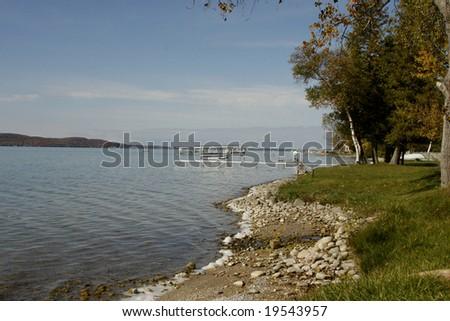 The beach at Crystal Lake in Northwestern Michigan - stock photo