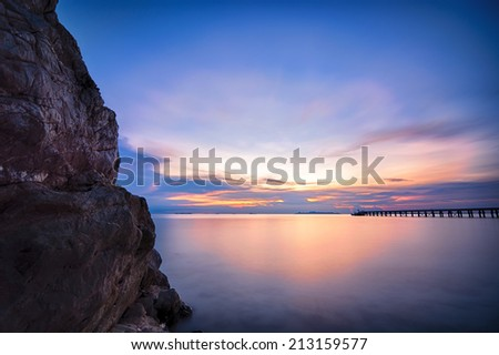 The beach from Thai island of Koh Samui. The picturesque pile of rocks on the beach, illuminated by the sunset. - stock photo