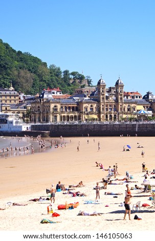 The beach of San Sebastian and a small part of the old town in the background - stock photo