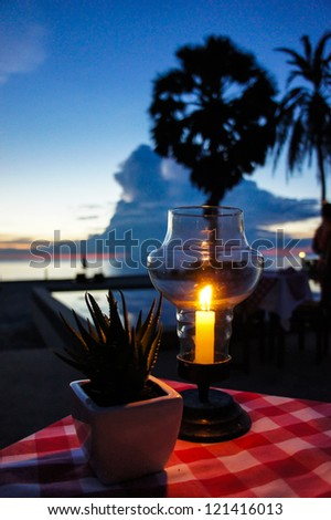 The beach side dining under candle light - stock photo