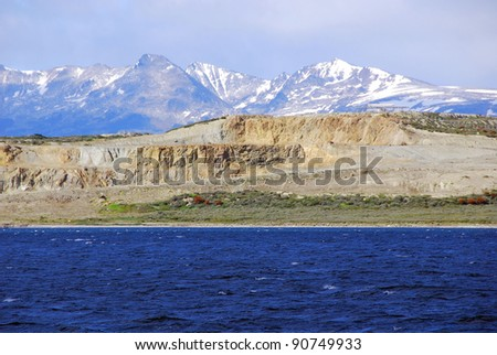 The Beagle Channel develops between several islands; to the north lies Argentine-Chilean Isla Grande de Tierra del Fuego, to the south Hoste, Navarino, and Picton and Nueva. - stock photo