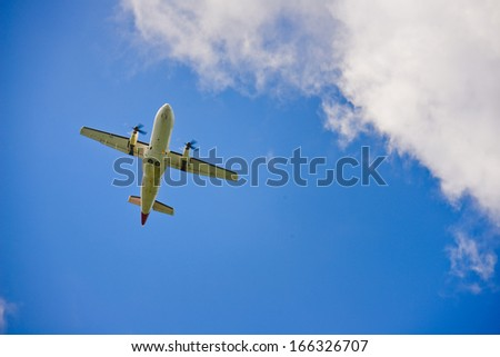 The beautiful air plane in blue sky - stock photo