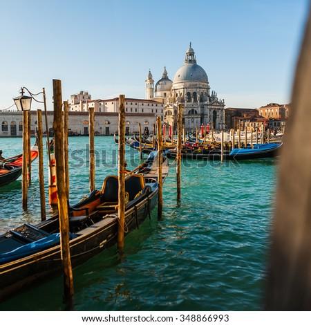 The beautiful and famous tourist destination spot Basilica Santa Maria della Salute in sunny weather on the Grand Canal, Venice, Italy - stock photo