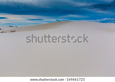 The Beautiful and Surreal White Sands and Wind Sculpted Dunes of White Sands Monument National Park in New Mexico. - stock photo