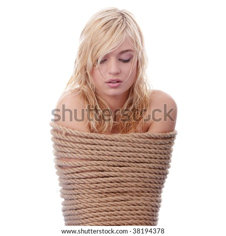 The beautiful blond girl tied with rope - kidnapping concept - stock photo