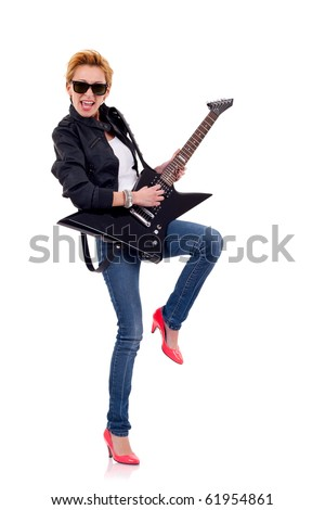 The beautiful blonde girl wearing leather jacket with a guitar and a leg up - stock photo